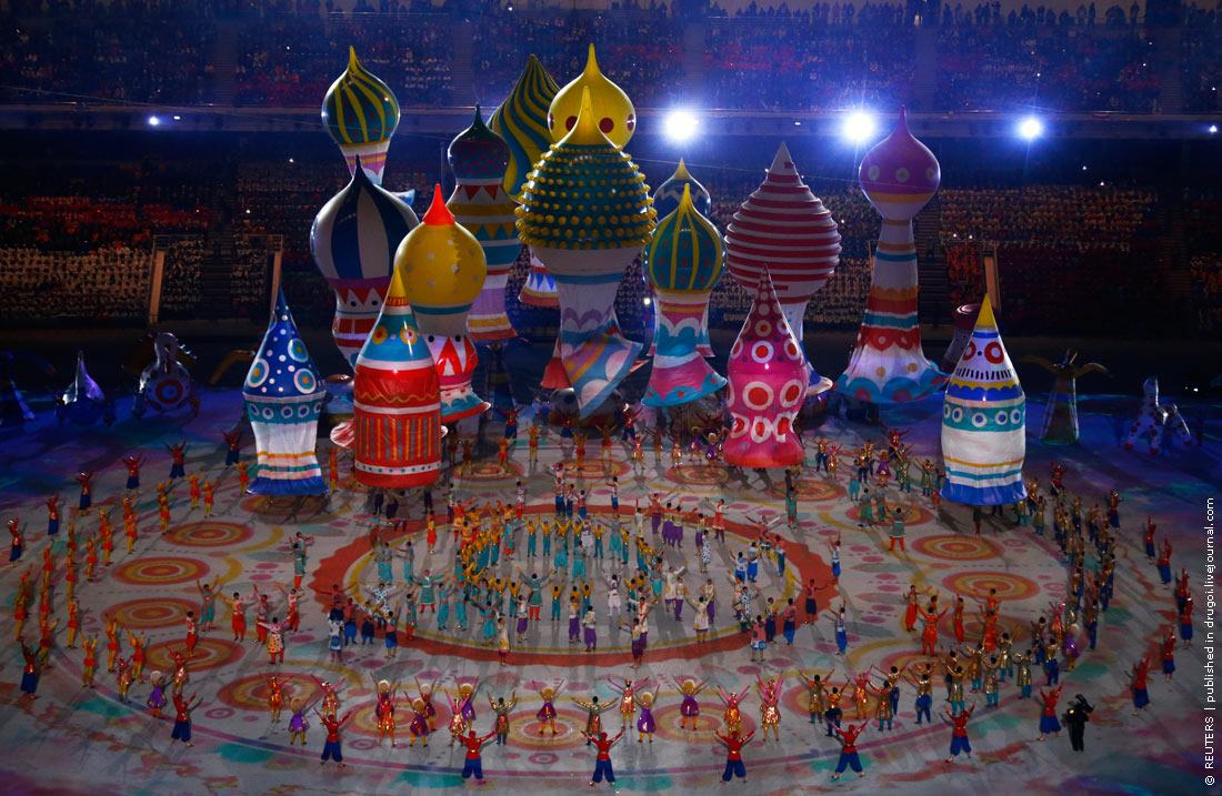 Performers dance near floats representing St. Basil's Cathedral during the opening ceremony of the 2014 Sochi Winter Olympics